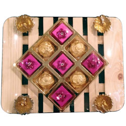 Exquisite Fusion of Scrumptious Assorted Handmade Chocolates with Marvelous Diya Candles