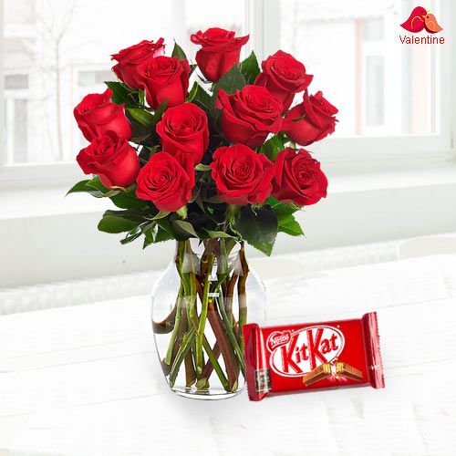Exclusive Dutch Red Roses in Vase with free Cadburys Chocolate