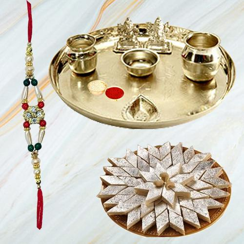 Irresistible Kaju Katli from Haldiram and Fancy Silver Plated Paan Shaped Puja Aarti Thali with Rakhi, Roli Tilak and Chawal for your Loving Brother