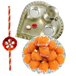 Classy Rakhi Wishes Gift of Haldiram Laddoo and Silver Plated Paan Shaped Puja Thali with Rakhi, Roli Tilak N Chawal for your Dear Brother