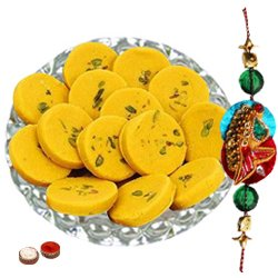Gorgeous Arrangement of Haldiram Kesaria Pedas with One Free Rakhi, Roli Tilak and Chawal for your Caring Brother