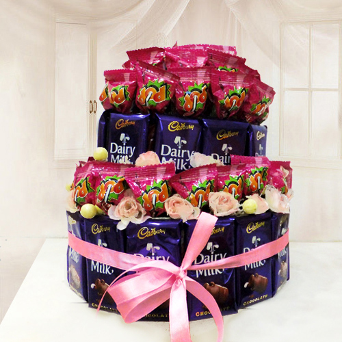 Arrangement of Cadbury Dairy Milk with Lollipops