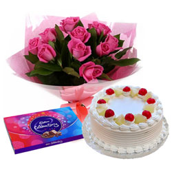Festive Greetings Cadbury Celebration with Cake and Pink Rose Bouquet