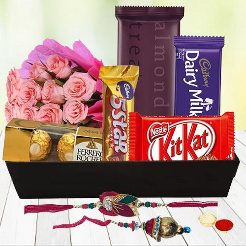 Sweet N Savory Chocolate Hamper with Pink Roses with Bhaiya Bhabhi Rakhi, Roli, Tilak and Chawal
