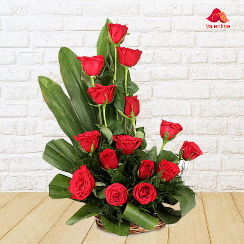 15 Exclusive Dutch Red Roses  in Cane Basket