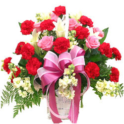 Romantic Pink Roses and Red Carnations in a Basket