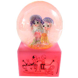 Magnificent Love Couple in LED Lighted Glass Globe with Floating Tinsel